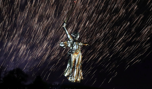 Fireworks explode over the statue Motherland Calls, a World War Two memorial located on the top of Mamayev Kurgan hill, during a light and laser show dedicated to the 73rd anniversary of the victory over Nazi Germany in World War Two, in Volgograd, Russia May 8, 2018. (Photo by Tatyana Makeyeva/Reuters)