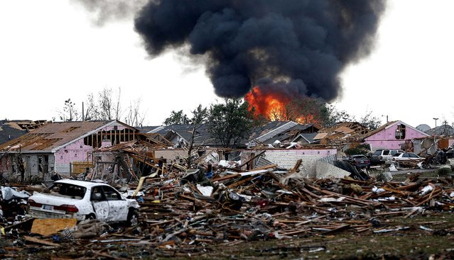 A fire burns in the Tower Plaza Addition in Moore. (Photo by Sue Ogrocki/Associated Press)