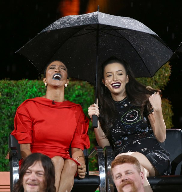 """Actors Sonequa Martin and Christian Serratos speak onstage during  AMC presents """"Talking Dead Live"""" for the premiere of """"The Walking Dead"""" at Hollywood Forever on October 23, 2016 in Hollywood, California. (Photo by Joe Scarnici/Getty Images for AMC)"""