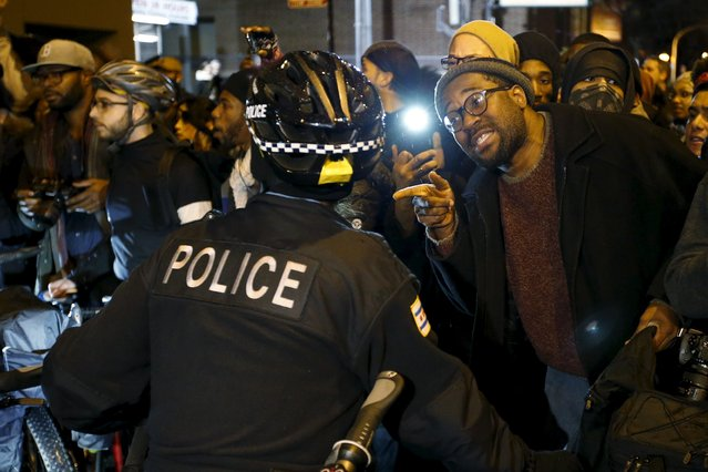 Protesters confront police officers during a demonstration in response to the fatal shooting of Laquan McDonald in Chicago, Illinois, November 25, 2015. (Photo by Andrew Nelles/Reuters)