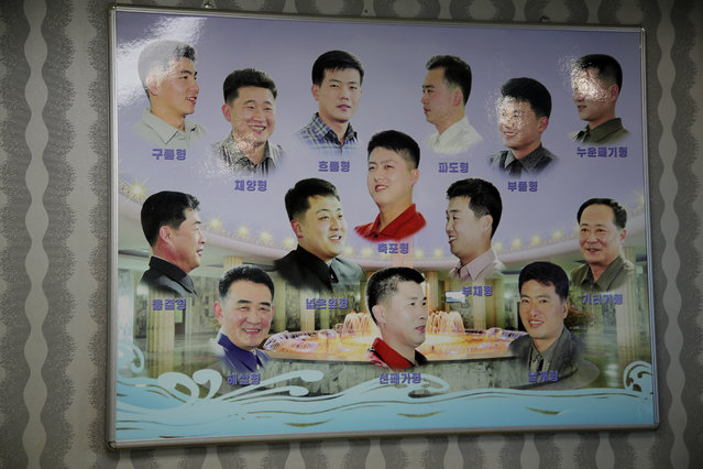 A poster showing different types of hair styles worn by North Korean men hangs outside a barber shop at the Munsu water park on Tuesday, December 1, 2015, in Pyongyang, North Korea. (Photo by Wong Maye-E/AP Photo)