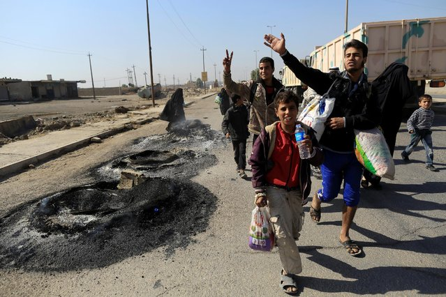 People who just fled Samah district of eastern Mosul react as they arrive at Iraqi Special Forces  checkpoint in Kokjali, east of Mosul, Iraq November 5, 2016. (Photo by Zohra Bensemra/Reuters)