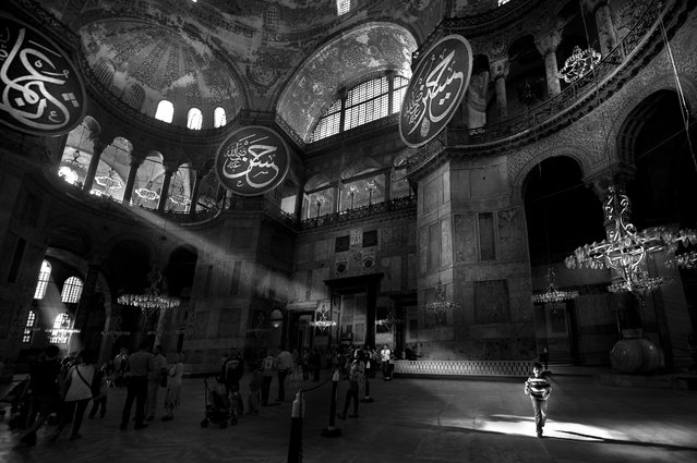 """Hagia Sophia Museum"". Hagia Sophia is the one of the most visited museums and most prominent monuments in the world in terms of art and the history of architecture. It has also been called ""the eighth wonder of the world"" by East Roman Philon as far back as the 6th century. It was used as a church for 916 years but, following the conquest of Istanbul by Fatih Sultan Mehmed, the Hagia Sophia was converted into mosque. Afterwards, it was used as a mosque for 482 years. Under the order of Atatürk and the decision of the Council of Ministers, Hagia Sophia was converted into a museum in 1935. Location: Istanbul, Turkey. (Photo and caption by Melih Sular/National Geographic Traveler Photo Contest)"