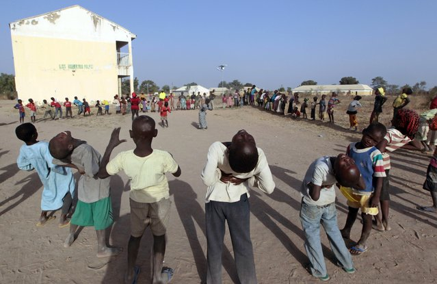 Children, who have fled Boko Haram violence in the northeast region of Nigeria, take part in aerobic exercises at Maikohi secondary school at the camp for internally displaced people (IDP) in Yola, Adamawa State January 13, 2015. (Photo by Afolabi Sotunde/Reuters)