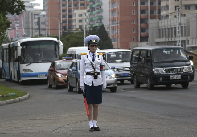 A traffic police officer stands in the middle of a road in Pyongyang, North Korea, Tuesday, June 19, 2018. (Photo by Dita Alangkara/AP Photo)