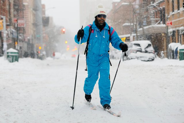 A man skis through the East Village during a snow storm, amid the coronavirus disease (COVID-19) outbreak, in the Manhattan borough of New York City, New York, U.S., February 1, 2021. (Photo by Andrew Kelly/Reuters)