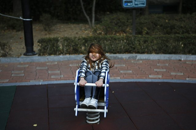Yoo Ga-eul plays in a playground in Seoul November 15, 2014. (Photo by Kim Hong-Ji/Reuters)