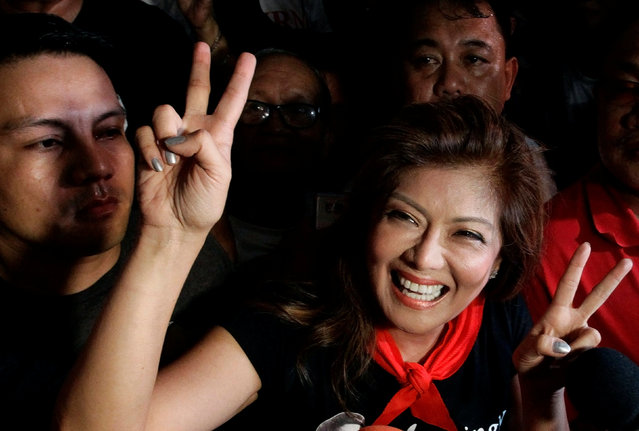 Governor Imee Marcos, daughter of late dictator Ferdinand Marcos gestures after the Supreme Court has allowed a hero's burial for the late dictator in Manila, Philippines November 8, 2016. (Photo by Czar Dancel/Reuters)