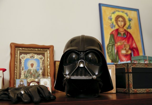 Darth Mykolaiovych Vader's Darth Vader helmet sits on a shelf among icons at his apartments in Odessa, December 2, 2015. (Photo by Valentyn Ogirenko/Reuters)