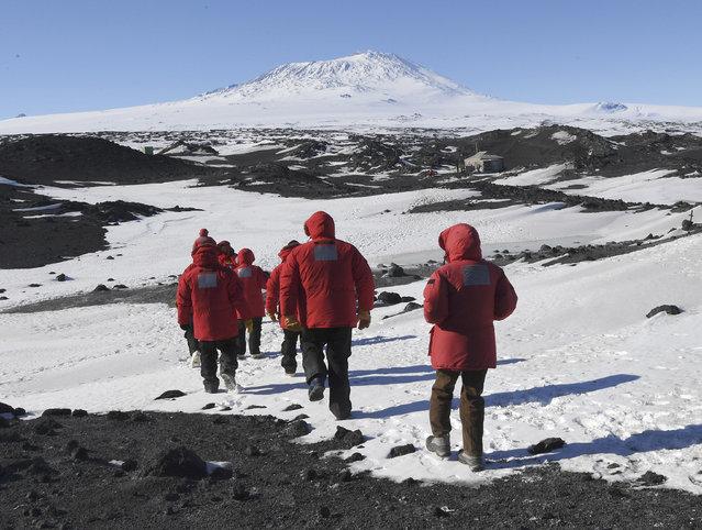 U.S. Secretary of State John Kerry and members of his delegation hike towards the historic Shackleton hut near McMurdo Station, Antarctica on Friday, November 11, 2016. (Photo by Mark Ralston/Pool Photo via AP Photo)
