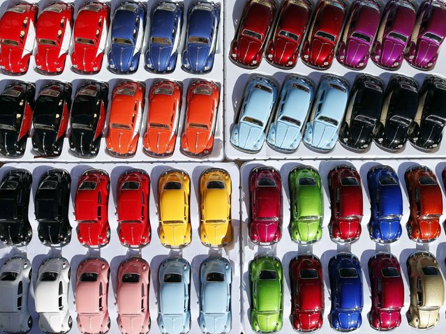 Miniature models of Volkswagen beetle are displayed during a Volkswagen Beetle owners meeting in Sao Bernardo do Campo January 25, 2015. (Photo by Paulo Whitaker/Reuters)