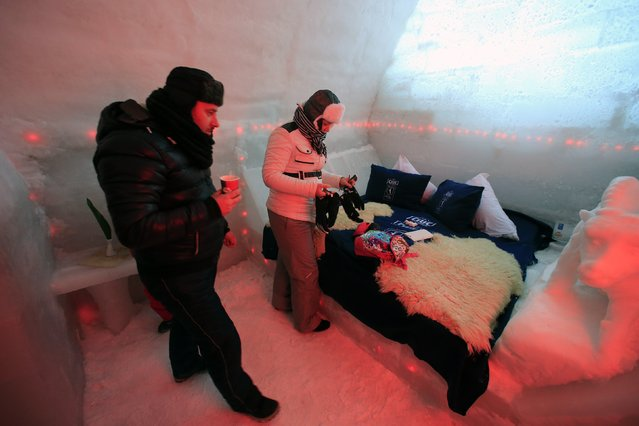 A couple of tourists visit a room inside the Balea Lac Hotel of Ice in the Fagaras mountains January 29, 2015. (Photo by Radu Sigheti/Reuters)