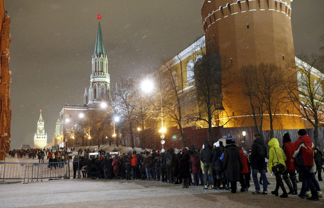 People stand in line for police checks at enter to the Red Square, Moscow, Russia 30 December 2015. Russians are preparing celebrate New Year 31 December and Christmas according to the Russian Orthodox' Julian Calender now 13 days after Christmas Day (25 December) on the Gregorian Calender. Red Square will be closed to visitors on 31 December. A security measure  Russia has reinforced during the New Year and Christmas holidays. (Photo by Maxim Shipenkov/EPA)