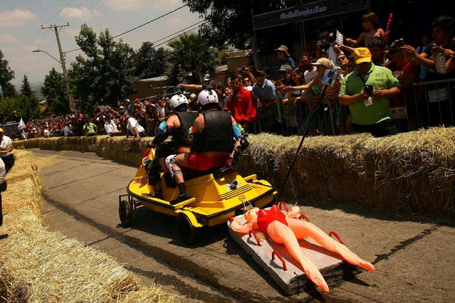 Competitors ride a home-made vehicle without an engine on a downhill track in the Red Bull Soapbox Race in Santiago, Chile, November 27, 2016. (Photo by Jonathan Faus/Reuters)