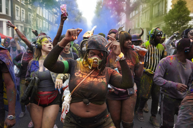 Early morning revellers celebrate Jouvertin Ladbroke Grove on August 26, 2018 as part of Notting Hill Carnival in London, England. The Notting Hill Carnival is recognised as Europe's biggest street festival. (Photo by Alex McBride/Getty Images)