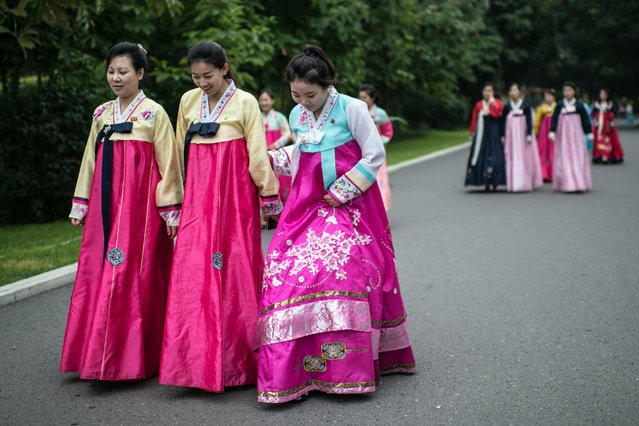 North Korean women in traditional dress walk to pay their respects to the Mansudae Grand Monument, huge statues of Kim Il-sung and Kim Jong-il, on August 19, 2018 in Pyongyang, North Korea. (Photo by Carl Court/Getty Images)