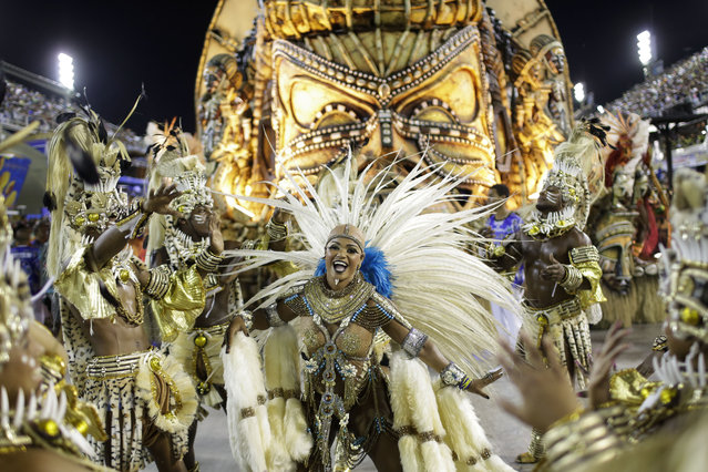 Beija Flor samba school performers parade during Carnival celebrations at the Sambadrome in Rio de Janeiro, Brazil, Tuesday, February 17, 2015. (Photo by Felipe Dana/AP Photo)