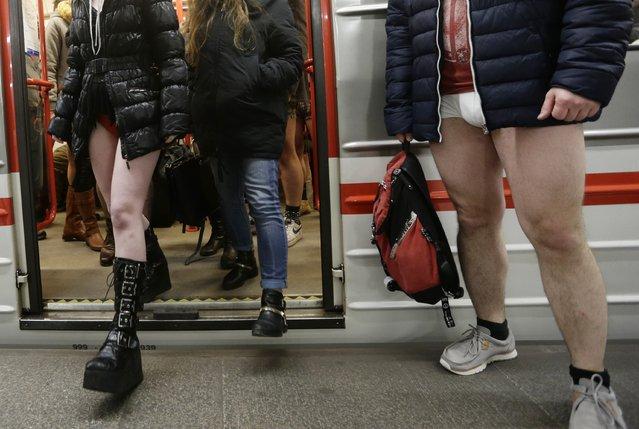 Passengers not wearing pants take part in the No Pants Subway Ride in Prague, Czech Republic, Sunday, January 10, 2016. (Photo by Petr David Josek/AP Photo)