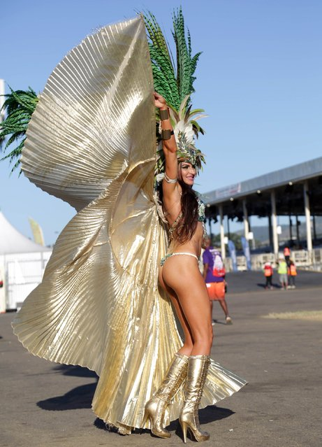"A masquerader from Hart's band ""Dominion Of The Sun"" prepares to go on stage during the band's presentation on stage at Queen's Park Savannah, Port-of-Spain February 17, 2015. (Photo by Andrea De Silva/Reuters)"