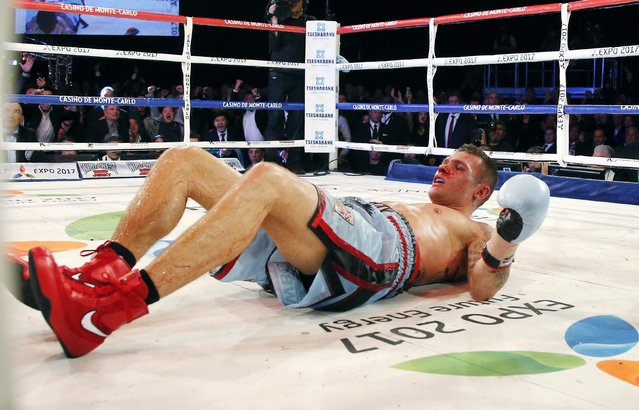 Martin Murray of England after being knocked down by World champion Gennadiy Golovkin of Kazakhstan during their WBA-WBC-IBO Middleweight World Championship fight in Monte Carlo, early February 22, 2015. Golovkin defended his title, defeating Murray in the 12 rounds. (Photo by Eric Gaillard/Reuters)