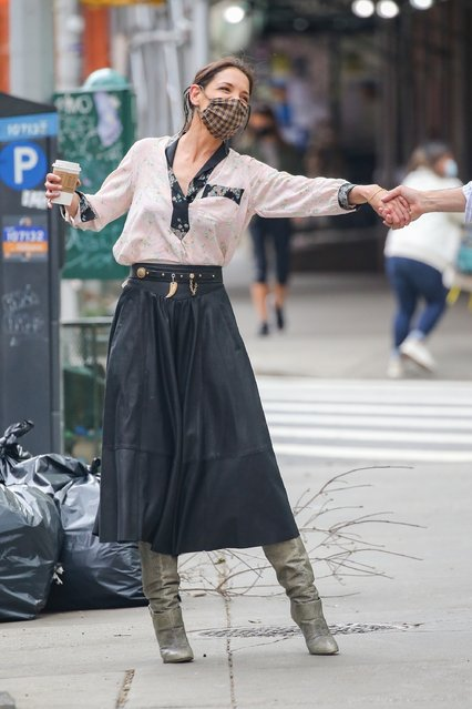 Actress Katie Holmes enjoys a walk in The Big Apple wearing a chic floral blouse paired with a leather skirt and booties on May 3, 2021. The actress turned her frown upside down after a coffee run. (Photo by Backgrid USA)