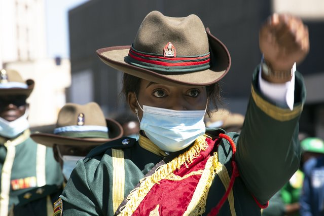 A member of the presidential guard marches during the unveiling of the statue of Charwe Nyakasikana in Harare, Tuesday, May, 25, 2021. Zimbabwe's president vowed to ensure the repatriation of the skull of a 19th-century anti-colonialist heroine who was hanged for leading resistance to white occupation, as he unveiled her bronze statue. Nehanda Charwe Nyakasikana, more widely known as Mbuya (grandmother in Shona) Nehanda, was hanged in 1898 for leading an anti–colonial rebellion. (Photo by Tsvangirayi Mukwazhi/AP Photo)