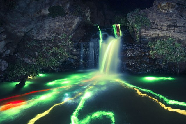 """Neon Luminance"" glowstick waterfall photography, California, America. (Photo by Sean Lenz/Kristoffer Abildgaard)"