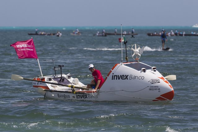 """Abraham Levy of Mexico rows his boat named """"Cascarita"""" as he arrives at the coast of Cancun March 14, 2015. Levy, who calls himself a """"self-propelled explorer"""", started out from the port of Palos in Spain on October 21, 2014, and travelled 9,000 km (5,592 miles) in 106 days to reach Cancun, aiming to raise awareness about preserving the Mesoamerican reef, in association with international organisation The Nature Conservancy. (Photo by Victor Ruiz Garcia/Reuters)"""