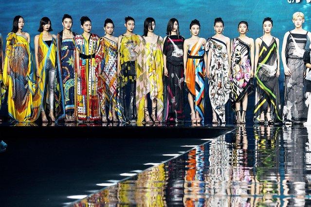 Models walk the runway during 2021 Yiwu Fashion Week at Yiwu International Expo Center on June 9, 2021 in Yiwu, Jinhua City, Zhejiang Province of China. (Photo by Gong Xianming/VCG via Getty Images)
