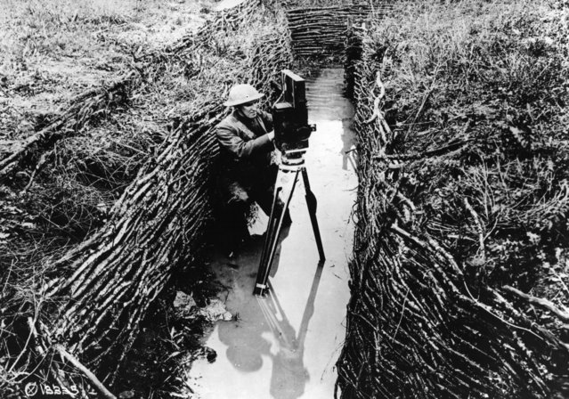 An American cinematographer sets up his camera in a water-filled trench, 1918. (Photo by Hulton Archive/Getty Images)