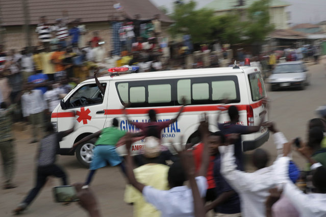 An ambulance races through Nigerians celebrating the anticipated victory of Presidential candidate Muhammadu Buhari in Kaduna, Nigeria Tuesday, March 31, 2015. (Photo by Jerome Delay/AP Photo)