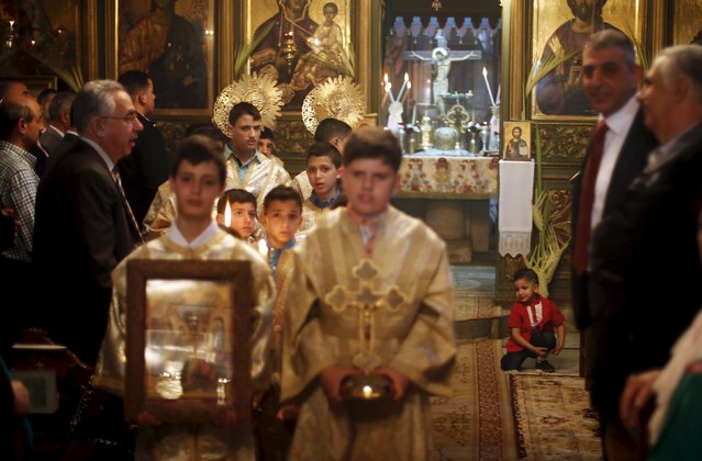 Palestinian boys attend Orthodox Christian Palm Sunday mass at the Saint Porfirios church in Gaza City April 5, 2015. (Photo by Suhaib Salem/Reuters)
