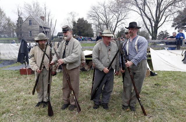 Confederate re-enactors practice stacking their arms as part of  commemoration of the 150th anniversary of the surrender of the Army of Northern Virginia at Appomattox Court House in Appomattox, Va., Thursday, April 9, 2015. (Photo by Steve Helber/AP Photo)