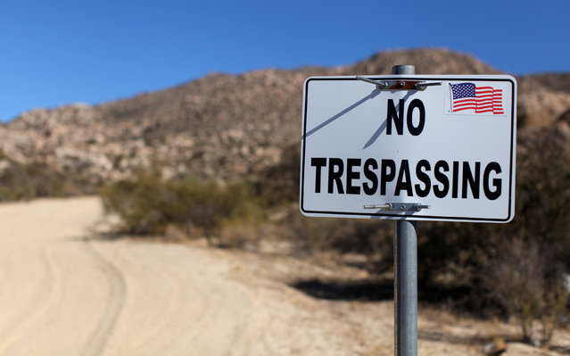 A sign stands on a private property near the U.S.-Mexico border fence near Jacumba, California, U.S., November 14, 2016. (Photo by Mike Blake/Reuters)