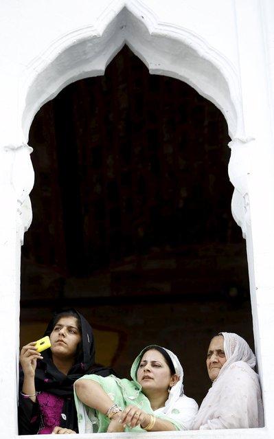 Sikh devotees watch the Baisakhi festival at Panja Sahib shrine in Hassan Abdel April 13, 2015. (Photo by Caren Firouz/Reuters)
