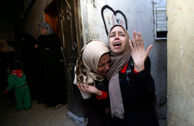 The sisters of Palestinian Ehab Abed mourn during his funeral in Rafah in the southern Gaza Strip, January 26, 2019. (Photo by Ibraheem Abu Mustafa/Reuters)