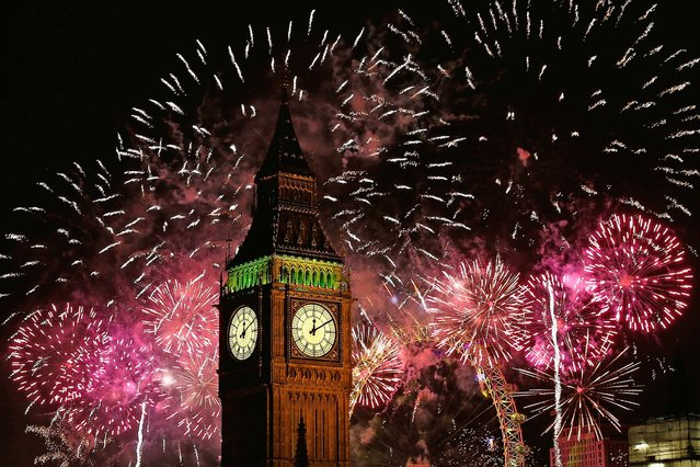 Fireworks light up the London skyline and Big Ben. (Photo by Dan Kitwood/Getty Images)