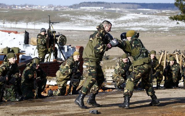"Belarussian soldiers display their skills at the ""Stalin Line"" memorial near the village of Goroshki, Belarus, February 27, 2016. (Photo by Vasily Fedosenko/Reuters)"