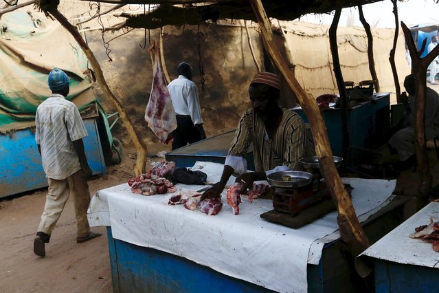 A man displays meat at Abo-Shouk internally-displaced persons camp at Al Fashir in North Darfur, Sudan February 17, 2016. (Photo by Mohamed Nureldin Abdallah/Reuters)