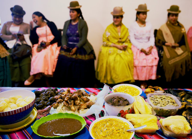 """An """"Aptapi"""" (Andean food) is seen after the Cholitas  practiced a the Rosario Aguilar fashion model school in La Paz, Bolivia, February 23, 2019. (Photo by David Mercado/Reuters)"""