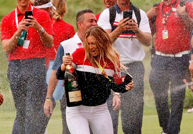 Partner of Team USA's Dustin Johnson, Paulina Gretzky celebrates with champagne after winning over Team Europe during Sunday Singles Matches of the 43rd Ryder Cup at Whistling Straits on September 26, 2021 in Kohler, Wisconsin. (Photo by Jonathan Ernst/Reuters)