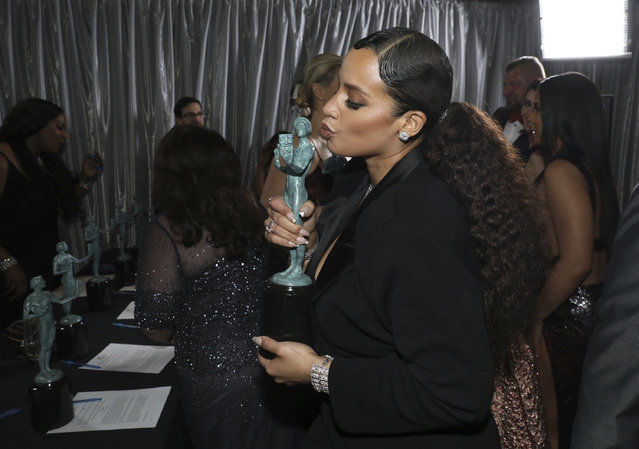 """Dascha Polanco, winner of the award for outstanding performance by an ensemble in a comedy series for """"Orange is the New Black"""", appears backstage at the 23rd annual Screen Actors Guild Awards at the Shrine Auditorium & Expo Hall on Sunday, January 29, 2017, in Los Angeles. (Photo by Matt Sayles/Invision/AP Photo)"""