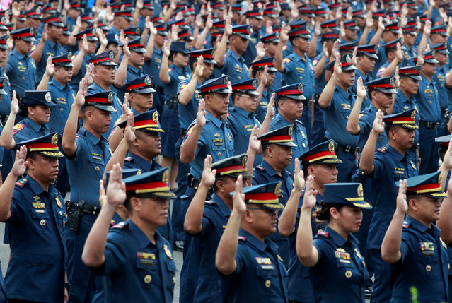 Police officers take their oath at the Philippine National Police (PNP) headquarters in Quezon city, Metro Manila, Philippines January 30, 2017. (Photo by Czar Dancel/Reuters)