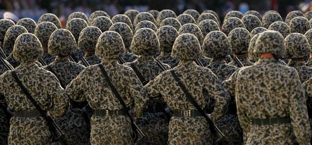 Vietnamese soldiers from a commando unit gather before marching during a military parade as part of the 40th anniversary of the fall of Saigon in Ho Chi Minh City (formerly Saigon), Vietnam, April 30, 2015. (Photo by Reuters/Kham)