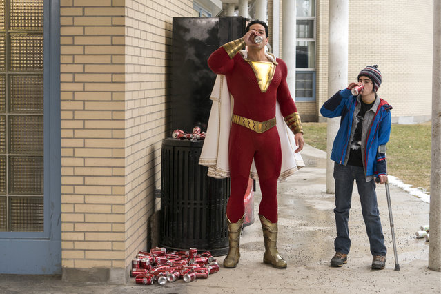 "This image released by Warner Bros. shows Zachary Levi, left, and Jack Dylan Grazer in a scene from ""Shazam!"". (Photo by Steve Wilkie/Warner Bros. Entertainment via AP Photo)"