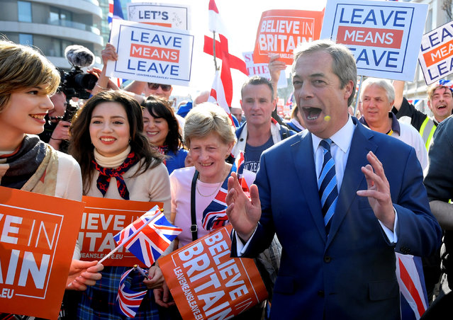 Brexit Party leader Nigel Farage attends a March to Leave demonstration in London, Britain March 29, 2019. The protest march which started on March 16 in Sunderland, north east England, finishes on Friday March 29 in Parliament Square, London, on what was the original date for Brexit to happen before the recent extension. (Photo by Toby Melville/Reuters)