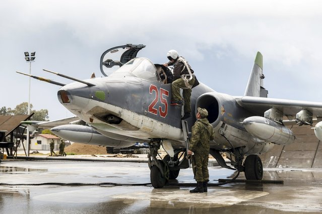 A Russian pilot gets inside a Sukhoi Su-25 fighter jet before the take-off, part of the withdrawal of Russian troops from Syria, at Hmeymim airbase, Syria, March 16, 2016. (Photo by Vadim Grishankin/Reuters/Russian Ministry of Defence)