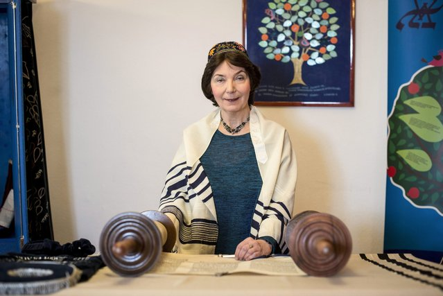 Hungary's only female rabbi Katalin Kelemen reads the Torah before a Shabbath service in the synagogue of the Sim Shalom Progressive Jewish Congregation in central Budapest, Hungary, 05 March 2016. (Photo by Bea Kallos/EPA)