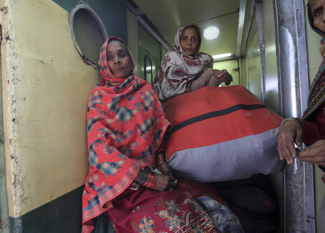 Passengers onboard a train on their way back to India, after being stranded in Pakistan for a week, at Lahore Railway Station in Pakistan, Monday, March 4, 2019. (Photo by K.M. Chaudary/AP Photo)