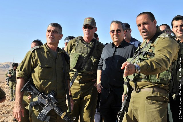 Israeli Defense Minister Ehud Barak visits the scene following series of coordinated gun and roadside bomb attacks against miltary and civilian targets near the Israeli - Egyptian border